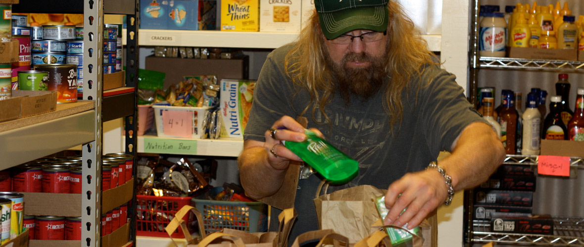 man filling grocery order at food pantry